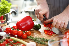 Male Hands Slicing Red Organic...