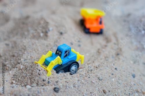 children toy truck on sand. concept of transportation and  building materials
