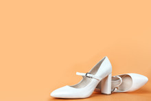 White High Heel Women's Shoes On A Orange Background. Side View, Close Up. Stylish Trendy Shoes For The Spring And Summer Season. Feminine Fashion Concept. Legendary Mary Jane Shoes. Copy Space