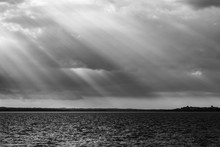 Sunrays At Near Sunset, With Dark Clouds In The Background, Above Trasimeno Lake (Umbria, Italy)
