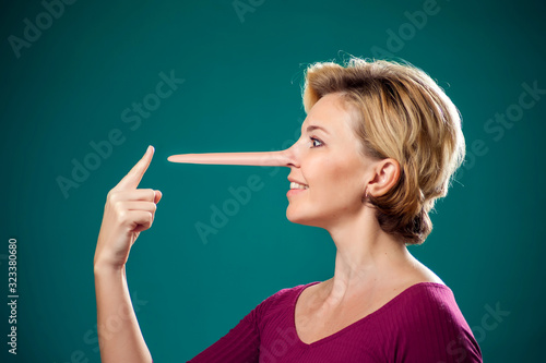 Canvas Print Woman touching her long nose because of lie