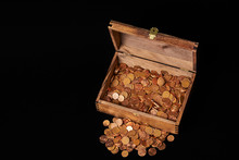 Euro Coins In Chest On Black Backgrtound. View From Top
