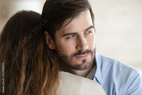 Pensive young man hug wife think of relationship problems Wallpaper Mural