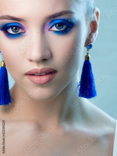 Fototapeta Glamorous bright eye makeup using the trend color classic blue, women's eyes close-up. obraz