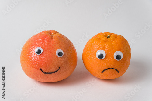 Funny food - tangerines couple with eyes Canvas Print