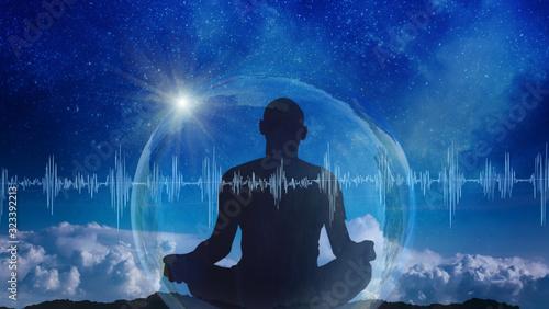 Obraz Yoga cosmic space meditation illustration, silhouette of man practicing outdoors at night - fototapety do salonu