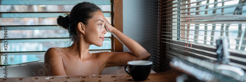 Luxury bath Asian woman relaxing in warm water enjoying view from bathroom window lying in bathtub banner panorama Fototapete