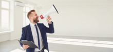 Male Real Estate Agent Shioting In Megaphone Smiling In White Real Estate Room Apartment Home