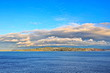 Various panoramic views of the coastline and Commencement Bay against the blue sky and clouds. Tacoma, WA, USA. October,2019.