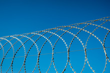 Razor Wire Fence Curving In Lo...