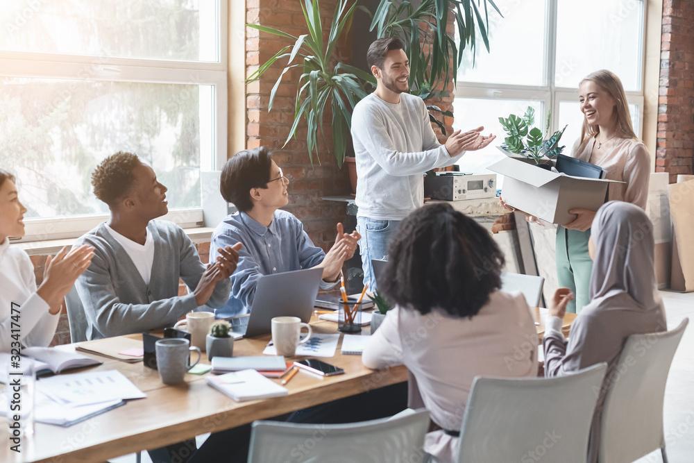 Fototapeta Positive multiracial business team greeting new employee