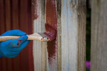 Painting The Fence In Red