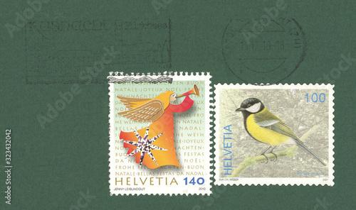 Fototapeta Briefmarke stamp Helvetia Schweiz Swiss Vogel bird Meise 100 Engel angel Weihnac