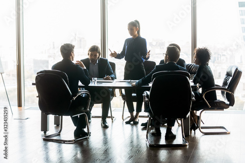 Serious businesswoman manager speaks in boardroom at meeting. Canvas Print