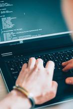 Software Development. Information Technology. Male Programmer Writing Code On Laptop.