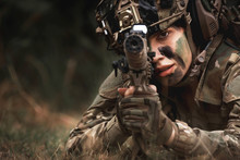 Close Up Of Woman Soldier Hold...