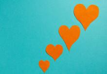 Orange Hearts On A Blue Background.