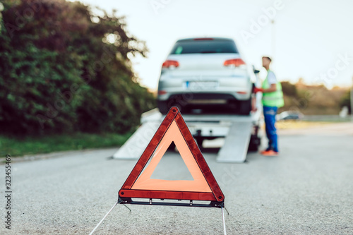 Handsome middle age man working in towing service on the road Canvas Print