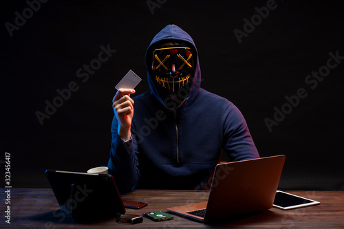 Fototapety, obrazy: young programming expert hacker going to hack computer system, find password from bank account. terrible crime made by guy in pullover using password cracking algorithm to gain access to a system