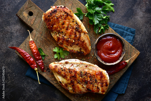 Obraz na plátne Grilled chicken fillet with spicy ketchup