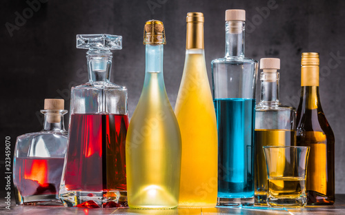 Cuadros en Lienzo Carafe and bottles of assorted alcoholic beverages.