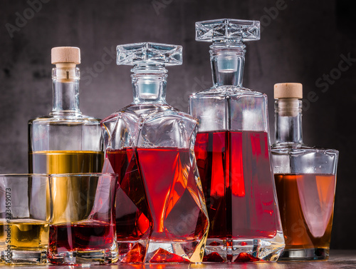 Fotomural Carafe and bottles of assorted alcoholic beverages.