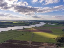 High Angle Shot Of Typical Dutch Landscape With The River Lek On The Left