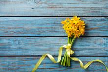 Spring Daffodil Flowers On Blu...