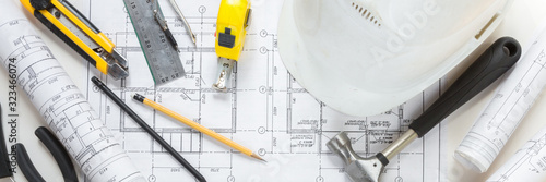 Fototapeta architect design working drawing sketch plans blueprints and making architectural construction model in architect studio,flat lay long banner. obraz