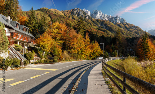 Wall mural - Awesome alpine highland in sunny day. Wonderful Summer landscape. Road in the mountains under sunlight. Dolomites, Slovenia. Amazing nature landscape. Picture of wild area.