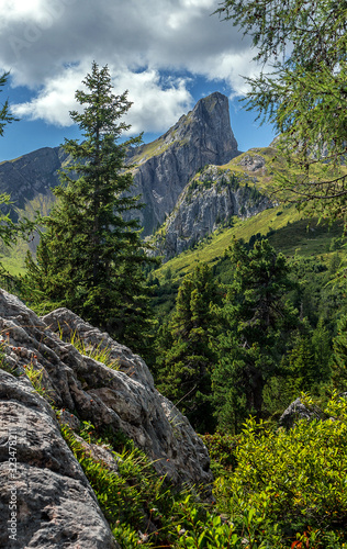Wall mural - Beautiful mountain view. Wonderful nature landscape. Amazing Sunny day in Dolomites Alps. Incredible natural scenery. Famous alpine place of the world. Picture of wild area
