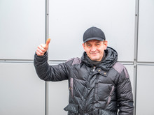 A Man With Hand Gestures Shows An Ok Sign On The Street. People. Winter Clothes. Place For Text. City Life