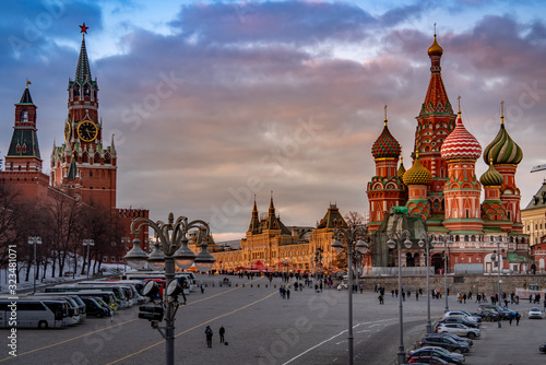 Wide angle view of the city of Moscow with Moscow Kremlin, TSUM and The Cathedral of Vasily the Blessed in winter at sunset Wallpaper Mural