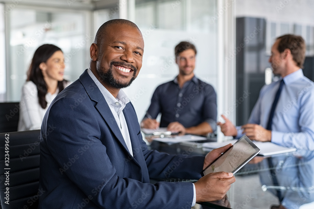 Fototapeta Mature african businessman at meeting