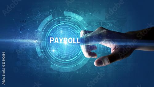 Hand touching PAYROLL button, modern business technology concept