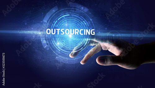 Hand touching OUTSOURCING button, modern business technology concept