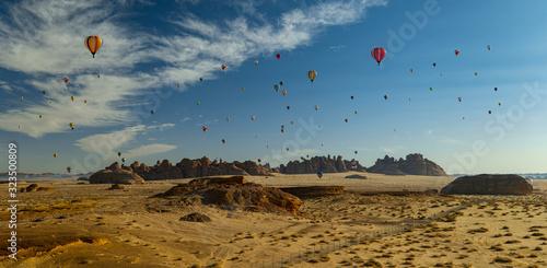 Fototapeta Winter at Tantora Hot Air Balloon Festival over Mada'in Saleh (Hegra) ancient si