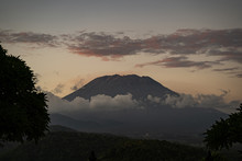 Beautiful Dormant Volcano Surrounded By Dense Clouds