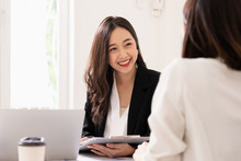 A Young Attractive Asian Woman Is Interviewing For A Job. Her Interviewers Are Diverse. Human Resources Manager Conducting Job Interview With Applicants In Office