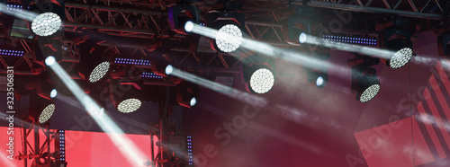 Obraz Photography of futuristic bright lighting of stage spotlight. Photography is suitable for postcard design, greeting card background, template. - fototapety do salonu