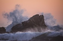 Wild Waves Hitting A Rock In A...
