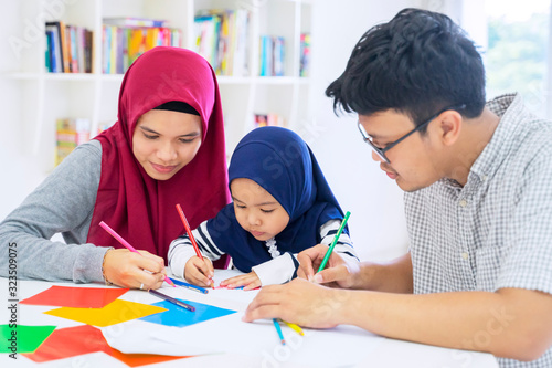 Asian muslim family drawing on origami papers Fototapeta