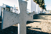 White Cross With A Cemetery In...