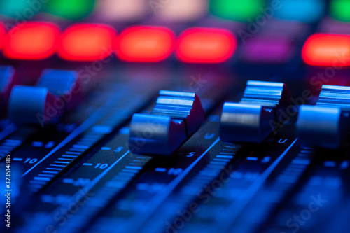 Fototapeta Volume control of the soundboard in blue light obraz