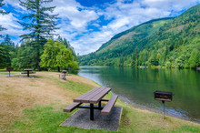 Picnic Tables Near Mountain Lake In Vancouver, Canada.