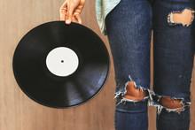 Female Hand Holds Vinyl Next T...