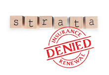 Strata Insurance Denied. Concept For Strata Building Insurance Crisis. Insurance Renewal Denied Or Unable To Get. Woodblock Letters And Red Circle Stamp. Isolated On White.
