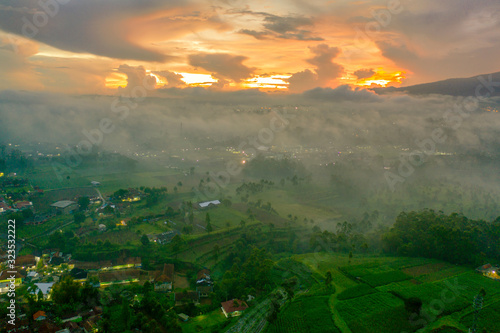 Aerial view of village and plantation on morning