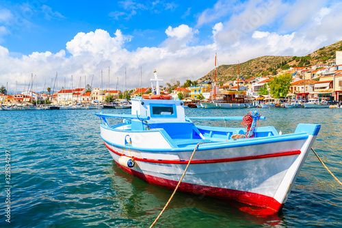 Typical colourful fishing boat in Pythagorion port, Samos island, Aegean Sea, Gr Wallpaper Mural