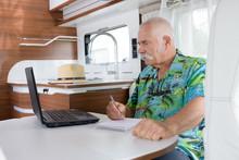 Senior Man Using A Laptop In A...